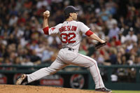 Craig Breslow pitching for the Red Sox